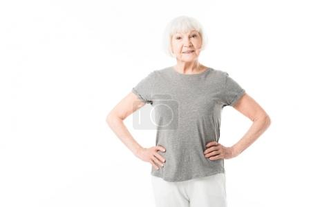 Senior woman standing with hands on waist isolated on white