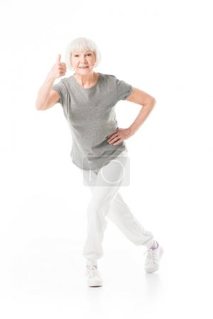 Photo for Senior sportswoman showing thumb up gesture isolated on white - Royalty Free Image
