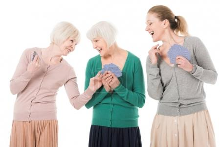 Stylish women playing cards isolated on white