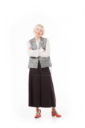 Smiling senior businesswoman in formal wear isolated on white