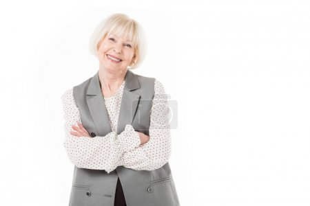 Photo for Portrait of smiling senior businesswoman with crossed arms isolated on white - Royalty Free Image