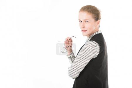 Stylish mature businesswoman holding eyeglasses isolated on white