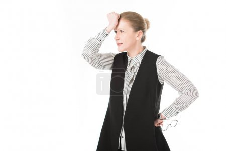 Upset mature businesswoman with eyeglasses in hand holding hand on forehead isolated on white