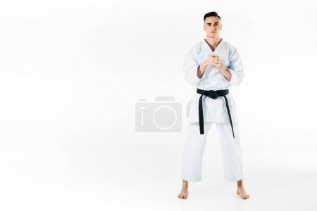 Photo for Male karate fighter stretching fingers isolated on white - Royalty Free Image