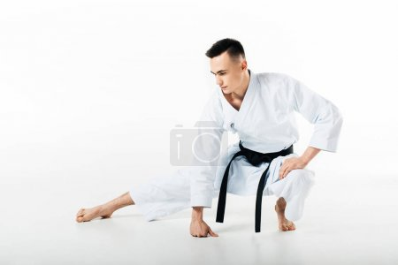 Photo for Male karate fighter stretching isolated on white - Royalty Free Image