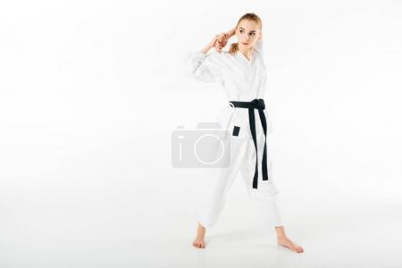 female karate fighter stretching hands isolated on white