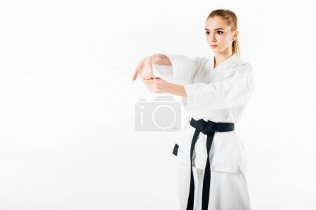 Photo pour Combattant de karaté femelle étirant les mains isolées sur blanc - image libre de droit