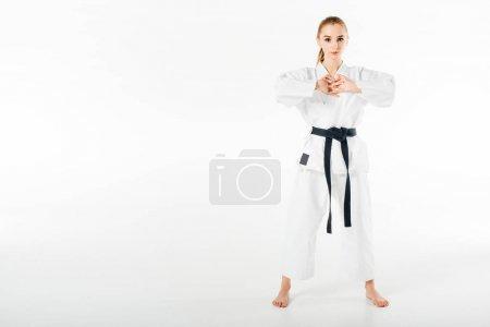 Photo pour Combattant de karaté femelle étirant les doigts isolés sur blanc - image libre de droit