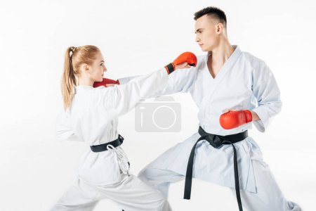 sportive people fighting in karate kimono and gloves isolated on white