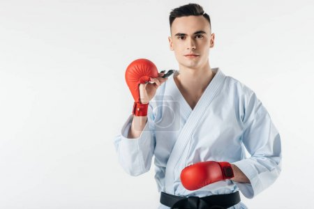 male karate fighter with mouthguard isolated on white
