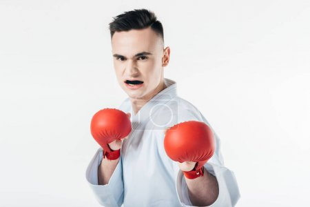 male karate fighter with gloves and mouthguard isolated on white
