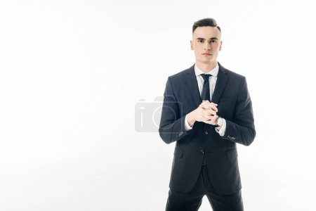 handsome businessman stretching fingers isolated on white