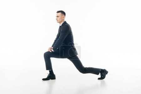 Photo for Businessman stretching legs in suit isolated on white - Royalty Free Image
