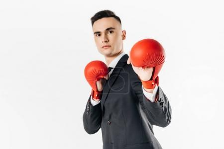 businessman in suit and red gloves looking at camera isolated on white