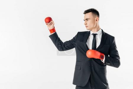 businessman in suit and red gloves isolated on white