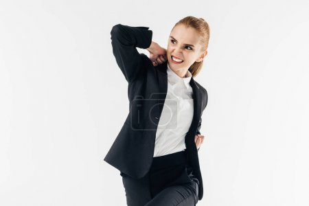 angry businesswoman rising elbow in suit isolated on white