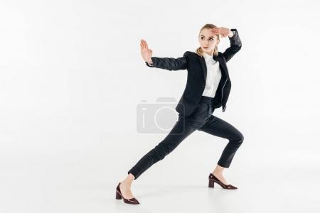 businesswoman in suit standing in karate position isolated on white