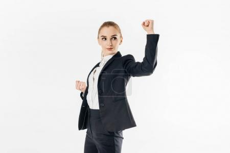 businesswoman standing in karate position in suit isolated on white