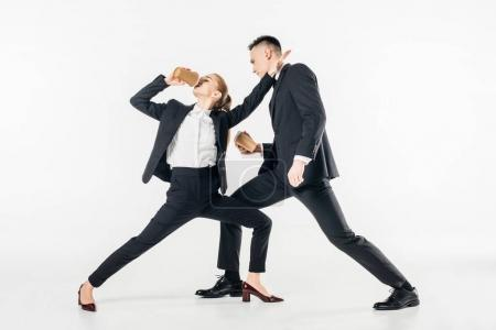 Photo for Businesspeople fighting and drinking coffee in suits isolated on white - Royalty Free Image