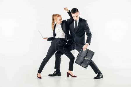 businesspeople fighting in suits with laptop and bag isolated on white