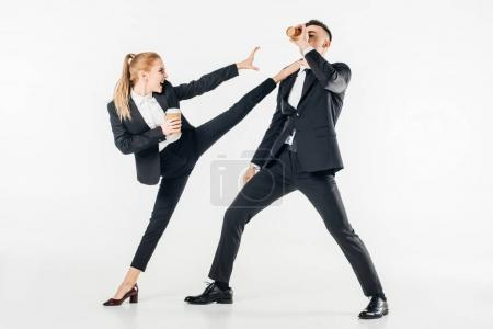 Photo for Businesswoman in suit kicking businessman with coffee to go isolated on white - Royalty Free Image