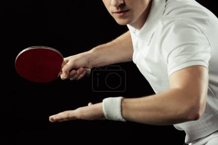 partial view of tennis player with tennis racket in hand