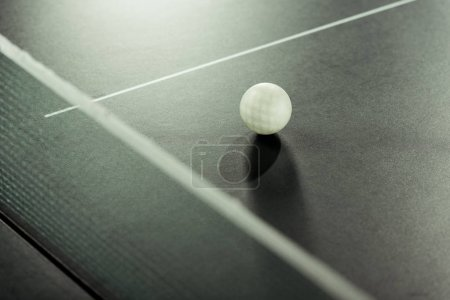 close up view of white tennis ball on tennis table