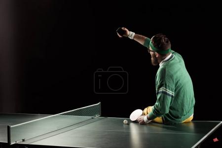 tennis player taking selfie on smartphone on tennis table isolated on black