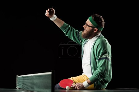 Photo for Smiling tennis player taking selfie on smartphone on tennis table isolated on black - Royalty Free Image