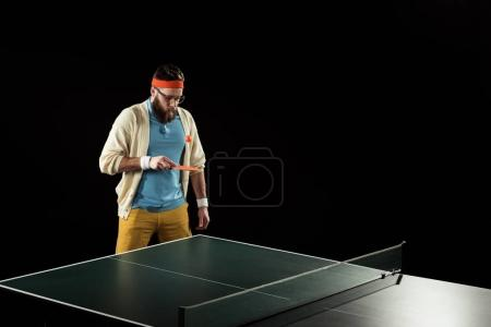 bearded tennis player practicing in tennis isolated on black