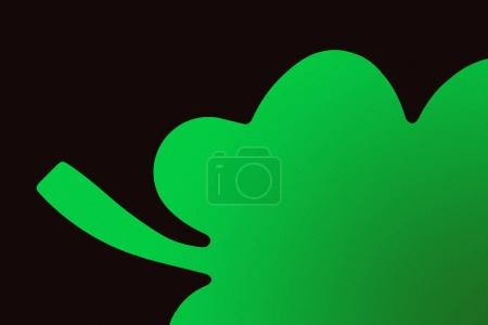 close-up view of green shamrock symbol isolated on black