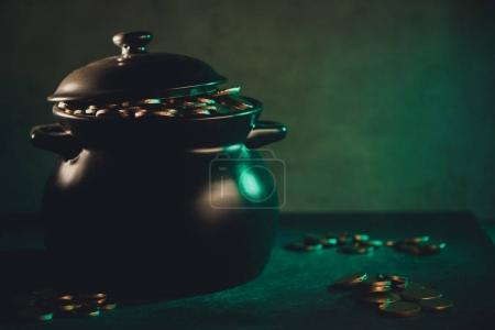 close-up view of pot full of golden coins, saint patricks day concept