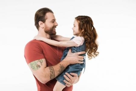 Side view of father holding little daugther in hands isolated on white