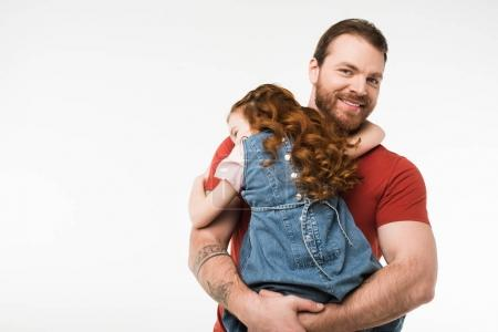 Rear view of little kid sitting on father hands isolated on white