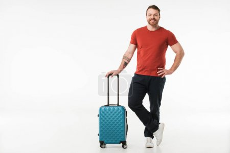 Stylish man standing with suitcase isolated on white, travel concept
