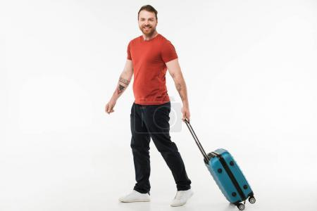 Man carrying suitcase isolated on white, travel concept