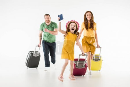 Happy running family with suitcases isolated on white, travel concept