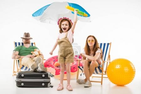 Photo for Father sleeping in sun loungers while daughter standing with water gun near mother isolated on white, travel concept - Royalty Free Image