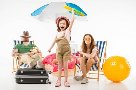 Father sleeping in sun loungers while daughter standing with water gun near mother isolated on white, travel concept