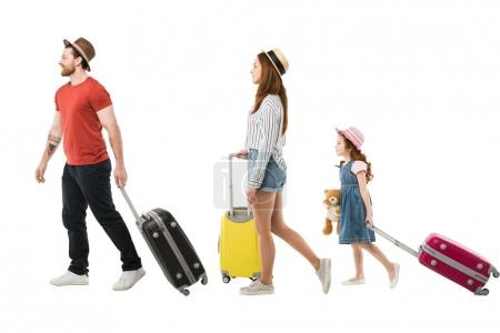 Photo for Stylish family of tourists carrying suitcases isolated on white, travel concept - Royalty Free Image