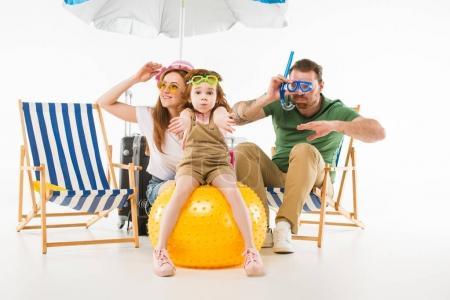 Family in swimming goggles depicting swim with sunshade, sun loungers and ball isolated on white, travel concept