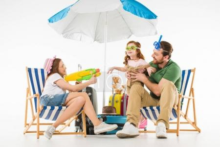 Photo for Father with daughter in swimming goggles and mother with water gun isolated on white, travel concept - Royalty Free Image