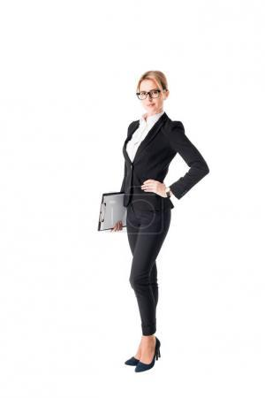 Blonde businesswoman holding clipboard isolated on white