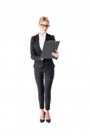 Blonde businesswoman looking at clipboard isolated on white