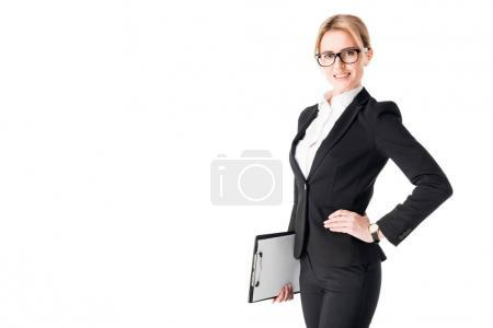 Leader businesswoman standing with clipboard in hands isolated on white