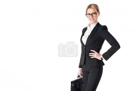 Young businesswoman wearing suit and holding briefcase isolated on white