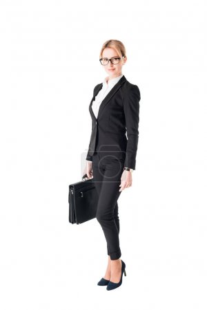 Leader businesswoman standing with briefcase in hands isolated on white