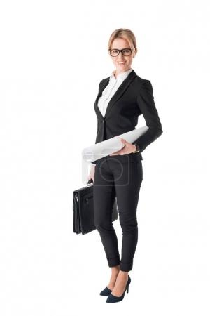 Blonde businesswoman holding clipboard and blueprint isolated on white