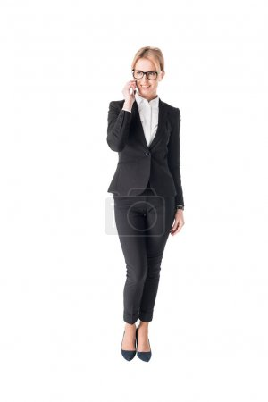 Confident businesswoman talking on smartphone isolated on white