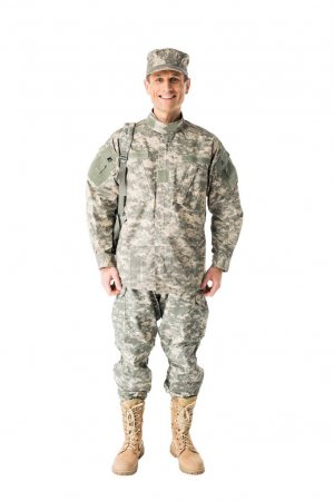 Young army soldier wearing uniform isolated on white